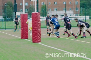 Nick Ryan busts through to score