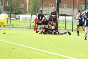 Josh Hill squeezes over against his old side.